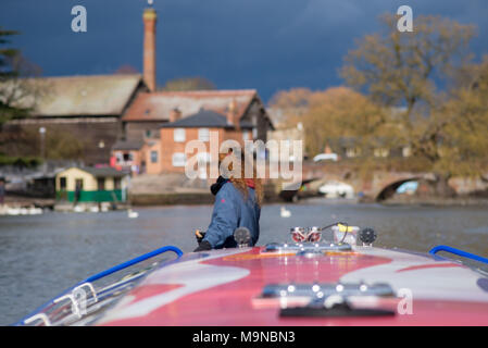 girl with red curly hair stood on front of canal boat with typical english buildings in background and fantastic light - Stock Photo