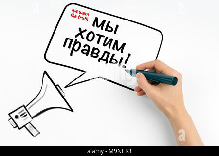 we want the truth, English and Russian. Megaphone and text on a white background - Stock Photo