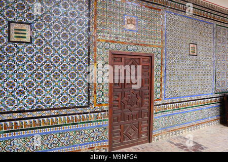 Casa de Pilatos, tiled wall with beautiful colored pattern, Moorish style, brown door, Seville, Spain, tiles - Stock Photo