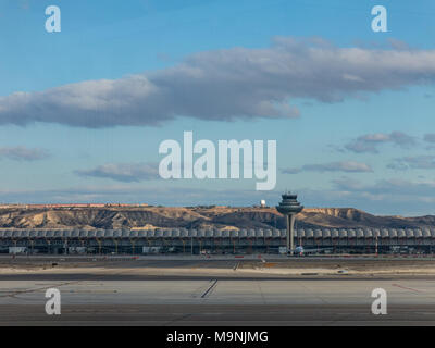 A plane prepares to take off on the runway of Terminal T4 the Adolfo Suarez Madrid Barajas Airport. Barajas is the main international airport serving - Stock Photo