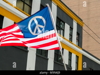 An American Flag Designed With A Peace Symbol Flies During The March