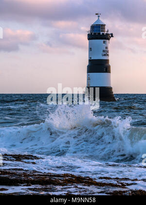 The Trwyn Du lighthouse watches over the treacherous waters between Penmon Point and Puffin Island, south east Anglesey, Wales, UK - Stock Photo