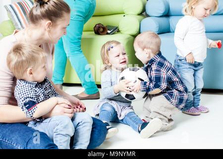 Children with foot ball indoor - Stock Photo