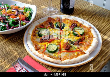 vegetarian pizza on white plate - Stock Photo