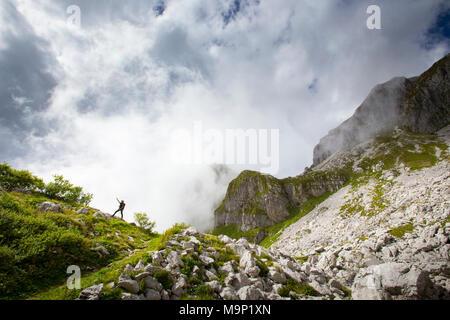 Park ranger of Triglav National Park pointing at Krn mountain, Slovenia - Stock Photo