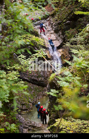 Canyoning In Narrow Gorge Filled With Rapids Pools And Waterfalls Soca Valley Near Bovec