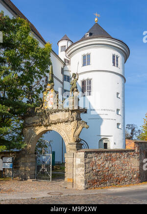 Portal with coat of arms of Saxony as entrance to Hartenfels Castle, Flaschenturm in the back, Torgau, Saxony, Germany - Stock Photo