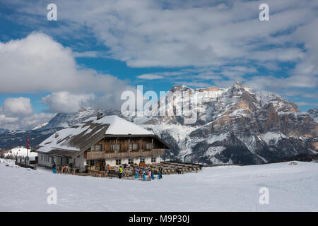 Mountain guesthouse Pralongià in the snow, ski area Alta Badia, Dolomiti Superski, in the back Sella massif, Corvara, Dolomites - Stock Photo