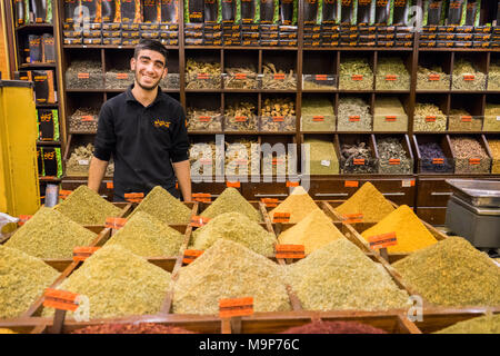 A man sells spices, herbs, nuts and Egyptian duqqa in a Spice Market in Amman, Jordan - Stock Photo