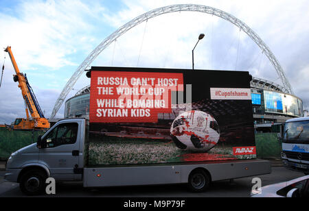 Activist group Avaaz with a billboard truck reading 'Russia can't host the World Cup while bombing Syrian kids' outside Wembley Stadium, as part of a campaign for the 2018 World Cup to be relocated from Russia, ahead of the international friendly match between England and Italy. - Stock Photo
