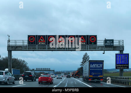 Electronic warning board with speed limit and traffic jam indicator, freeway A9, Bavaria, Germany - Stock Photo