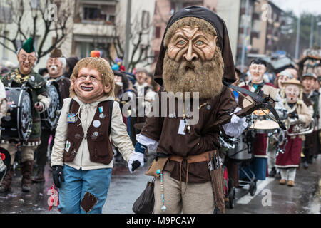 Wilhelm Tell with his son at the carnival procession of the Mättli Zunft in Littau, Lucerne, Switzerland - Stock Photo