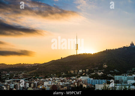 TV Tower Torre de Collserola, Collserola Tower on Tibidabo Hill, backlight at sunset, Barcelona, Catalonia, Spain - Stock Photo