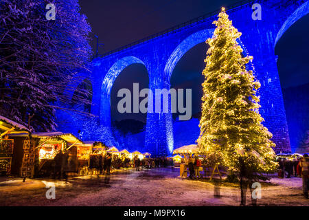 Snowy Christmas market under a railway viaduct, illuminated, Ravennaschlucht, Höllental near Freiburg im Breisgau, Black Forest - Stock Photo