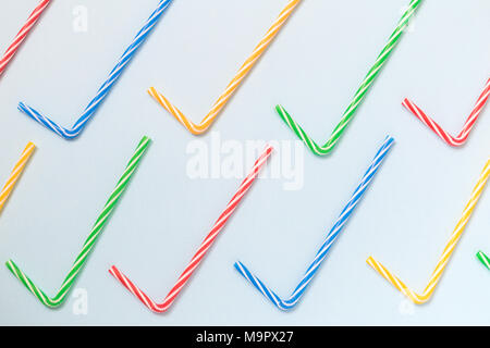 Pattern made of colorful drinking straws on pastel blue background minimal creative concept. - Stock Photo