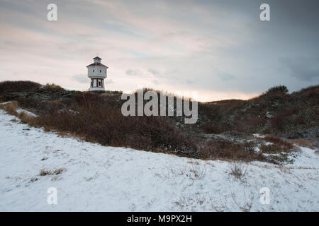 Water tower on snow-covered dunes in winter, Langeoog, East Frisia, Lower Saxony, Germany - Stock Photo