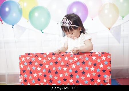 Baby girl celebrate her second birthday - Stock Photo