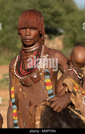 Woman with baby from the Hamer tribe in traditional dress, Turmi, Southern Nation Region, Ethiopia - Stock Photo
