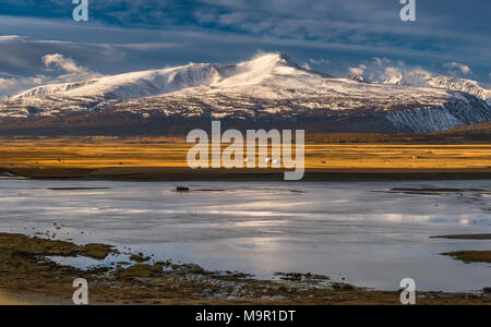 Khurgan Lake with snow-covered mountains in the back, Mongolia - Stock Photo