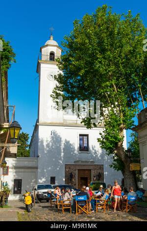 Street café in front of the church Matriz, Colonia del Sacramento, Uruguay - Stock Photo