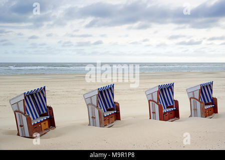 Beach chairs stand side by side in the sand on the beach, Norderney, East Frisian Islands, North Sea, Lower Saxony, Germany - Stock Photo