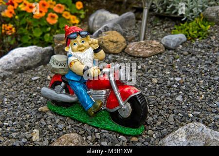 Garden gnome Rocker on motorcycle, Engelberg, Canton Obwalden, Switzerland - Stock Photo