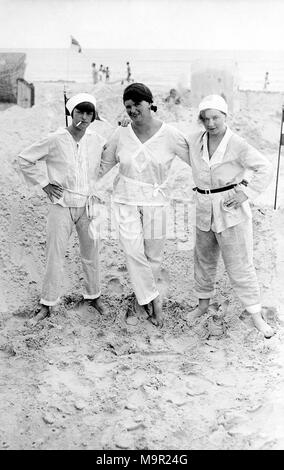 Three Women in Summer Suit on the Beach, 1920s, Germany - Stock Photo