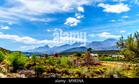 The Little Karoo region of the Western Cape Province of South Africa with the majestic Grootswartberg Mountains on the horizon - Stock Photo