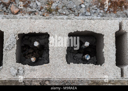 Detail of reinforced concrete blocks wall under construction. - Stock Photo