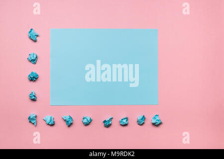 Two tone pink and blue contrast colored paper background with crumpled balls. Empty blank for text and design. - Stock Photo