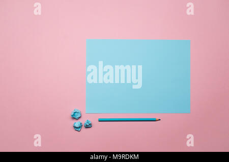 Two tone blue and pink contrast color paper background with crumpled balls and blue wooden pencil. Empty blank for text and design. - Stock Photo