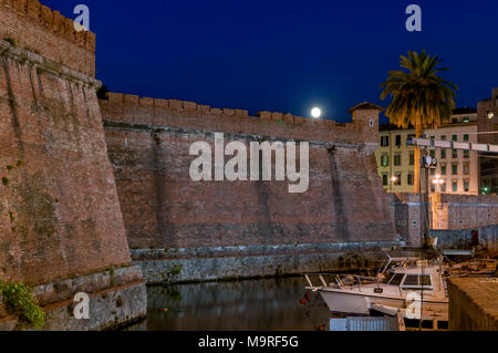 Beautiful night view of the Fortezza Nuova of Livorno in the Venezia district, Tuscany, Italy with full moon - Stock Photo