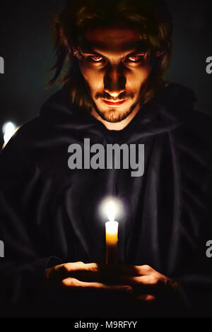 Warlock with a candle in the dark scary look Stock Photo