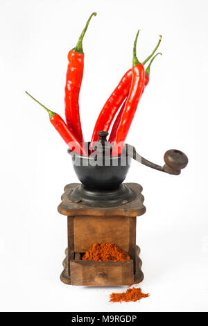 ground red pepper, grinder and paprikar on a white background - Stock Photo
