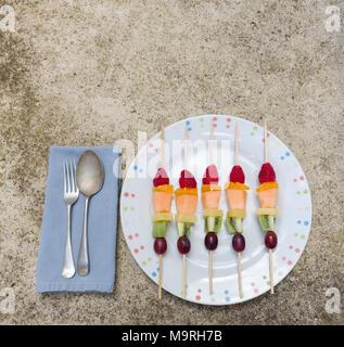 Fruit Skewers, Napkin, Fork, Spoon - Stock Photo