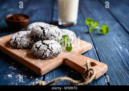Chocolate crinkle cookies with powdered sugar icing - Stock Photo