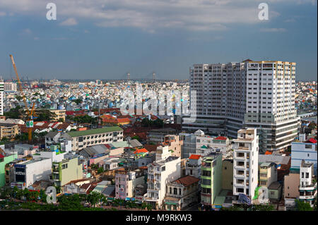 HO CHI MINH CITY, VIETNAM - APRIL 9, 2017: The sun sets over the Ho Chi Minh City skyline that mix the colonial and business district in Vietnam large - Stock Photo