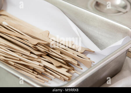 Wood Scrape tissue at the cervix in stainless sterile box. Cervical Screening Liquid - based Cytology (LBC) for (Pap smear) gynecology inspect EXAMINA - Stock Photo