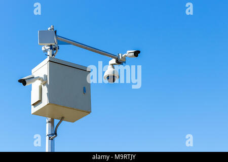 cctv camera on sky background Infrared camera and zoom tracking system. - Stock Photo