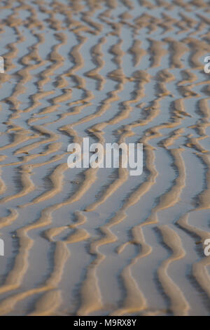 Ripples in sand left at low tide, Dorset UK - Stock Photo