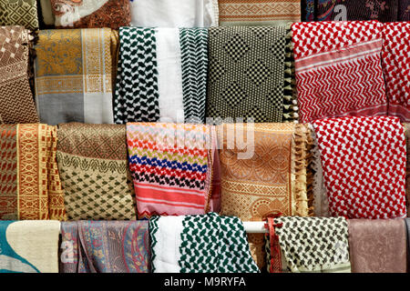 Shawls, scarves and sheets of the Bedouins and Palestinians in Petra, Wadi Musa, Jordan, middle east - Stock Photo
