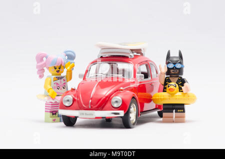 lego vacation batman and n-pop girl on vacation with volkswagen beetle. - Stock Photo