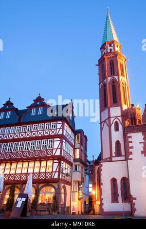Restaurant and Old Nikolai Church at Romerberg square, the old town center, Frankfurt, Hesse, Germany - Stock Photo