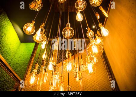 Old vintage fashion light bulbs. bottom view - Stock Photo