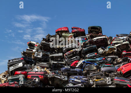 Stacked cars at a junkyard in Amsterdam - Stock Photo