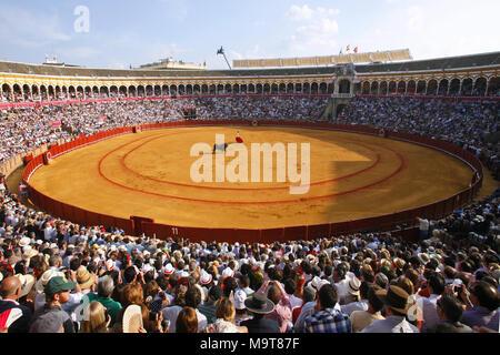 Bullfight during Feria de Abril Seville Fair, Plaza de toros de la Real Maestranza de Caballería de Sevilla Bullring, Seville, Spain - Stock Photo