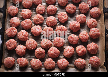 Raw meatballs on the tray - Stock Photo