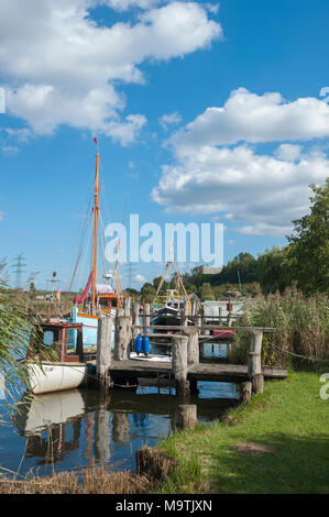 Fishing boats in natural harbor of the fishing village Gothmund at the river Trave, Gothmund, Baltic Sea, Schleswig-Holstein, Germany, Europe - Stock Photo