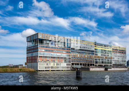 Unique modern design apartment building on the waterside 't IJ in Amsterdam the Netherlands. - Stock Photo