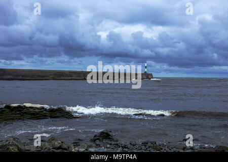 The stone jetty with oncoming thunderstorm in Aberystwyth Ceredigion Wales UK - Stock Photo